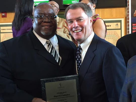 """The Rev. Preston T. Adams (left, with Indianapolis Mayor Joe Hogsett) received the Education Award from the Ten Point Coalition on June 3, 2016. """"They let young people see men that have been successful, particularly African-American men who have been successful, in our society because they pursued their education,"""" said the Rev. Charles Harrison, a coalition leader."""
