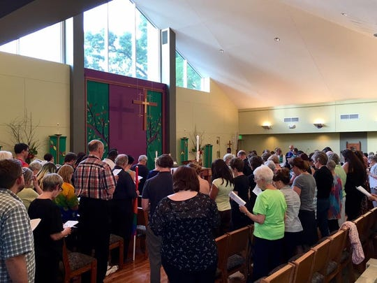 Some 200 community members attended Wednesday's vigil at St. Paul's Episcopal Church.