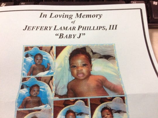 These photos of Baby J were handed out at his funeral.