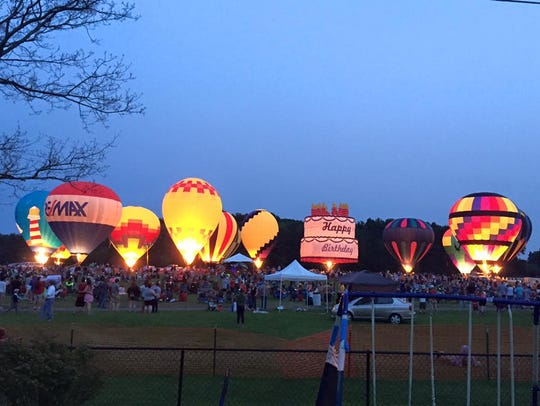 Hot air balloons light up the night sky during a balloon glow at the 2015 Ashland Balloonfest. The annual festival returns Thursday through Saturday.