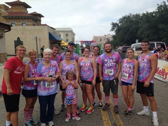 "In 2014, the Cajote family completed the Firecracker 5K for the first time, months after Wyatt and Tiffany were both released from the hospital. The group made matching tye-dye shirts for everyone in the family reading ""Team Wyatt."""