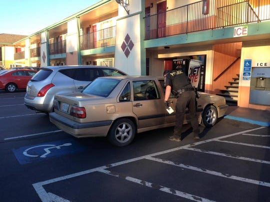 Yreka police investigate the scene of a shooting that left one man critically injured at a Super 8 Motel Tuesday.