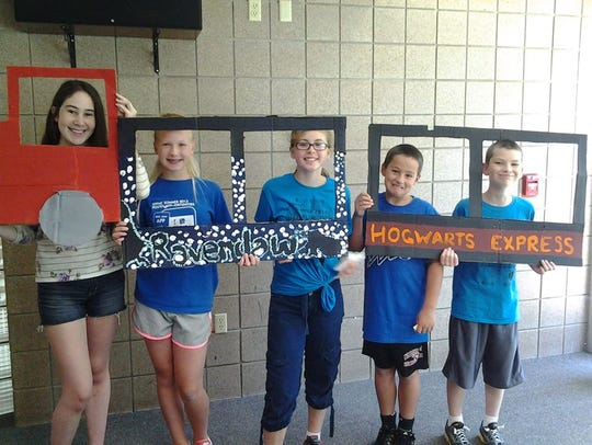 Campers show off the Hogwarts Express train cars they