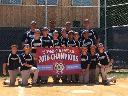 Poughkeepsie 10-and-under baseball team poses with its Middle Atlantic regional championship banner,