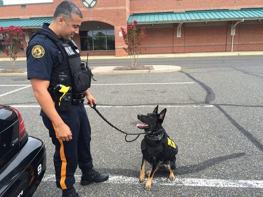 Mount Laurel Officer Wilmer Santiago with K-9 Nina