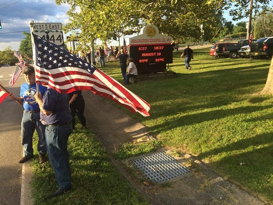 Some were not happy with the one American flag agreement and showed up to Arlington Fire District headquarters in the Town of Poughkeepsie for a rally Thursday evening.