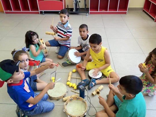 Students in Amman, Jordan, learn the sounds of different musical instruments during Take Note Studio's outreach workshop in July.