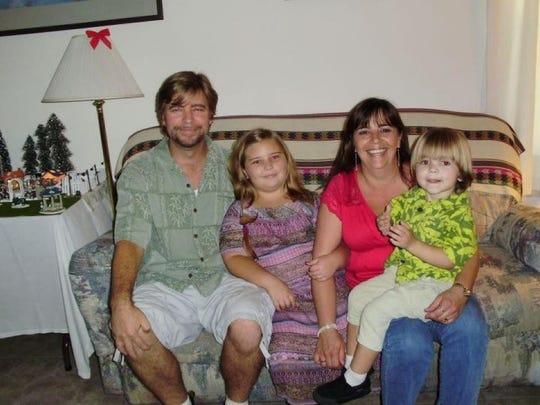 Marshall and Robin Mills' family photo. Robin, 43,