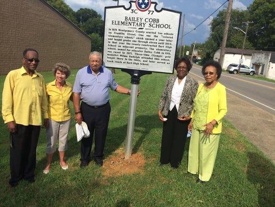 Mayor Kim McMillan joins members of the Bailey Cobb