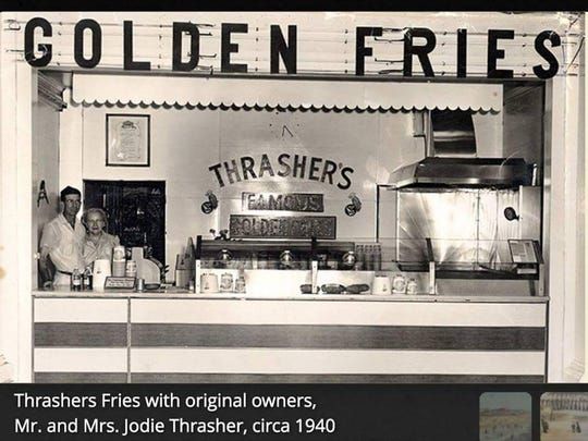 J.T. Thrasher stands with his wife, Jodi, at the original Thrasher's stand, circa 1940.