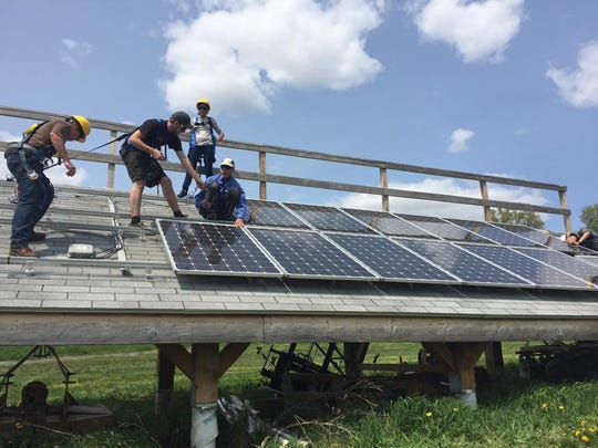 UVM students practice installing solar panels at a photo-voltaic installation certification course. Access to the course was initially denied by the Clean Energy Fund, but students brought their case to a Richard Cate, the university treasurer who supported the course through his own funds.