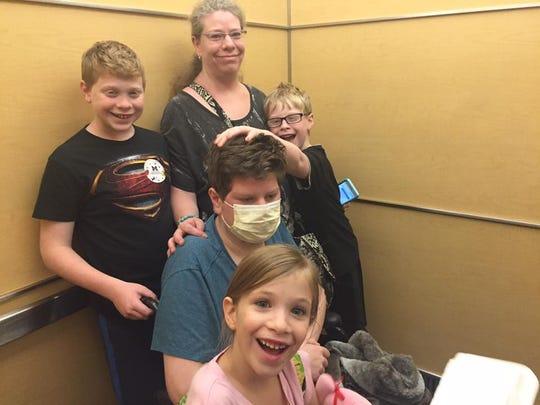 Trevor Sullivan, 15, with his family at C.S. Mott Children's