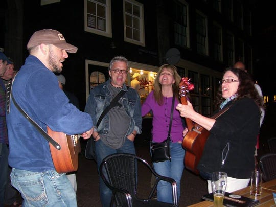 """Neil Young fan Terri Haram (second from right) of Venice, Florida, joins in singing Neil Young with other """"Rusties."""""""