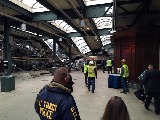 This photo provided by Brian Farnham shows the inside of the Hoboken station after a commuter train crash on Thursday, Sept. 29, 2016 in Hoboken, N.J.   A commuter train plowed into the bustling rail station during the morning rush hour Thursday, injuring more than 100 people in a tangle of broken concrete, twisted metal and dangling cables, authorities said.