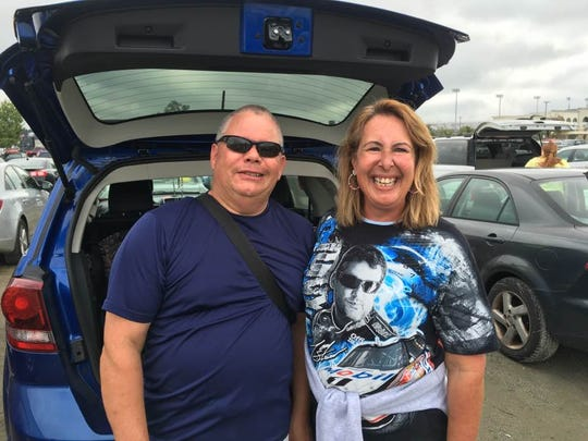Beth Muspratt of Bear, Del. poses in her Tony Stewart shirt with her boyfriend, Charlie, before the Sprint race at Dover on Oct. 2, 2016.