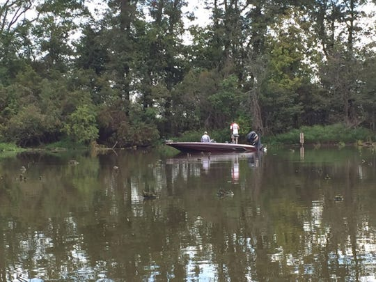 """Luke Estel fishing in """"The Gator Hole"""" off the Red River."""