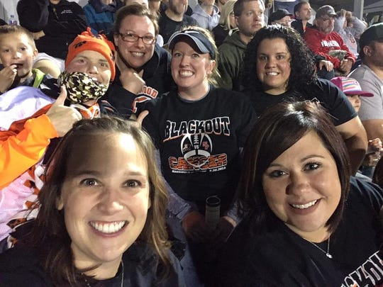 Lindsay Zuelke with friends at Blackout Cancer football game with proceeds from shirts going to Zuelke and her family.
