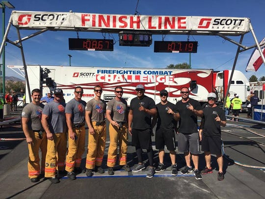 The team (four right) competed against Tuscaloosa Fire & Rescue Service for the no. 1 spot in nationals.