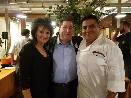 "Chef John and his wife Leslie, pictured with Louisiana Lt. Governor Billy Nungesser at ""Louisiana in the Lowcountry"" in Charleston, SC."