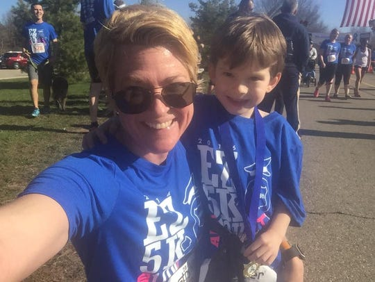 Christina Ellis with son Merrek at the EZ Memorial