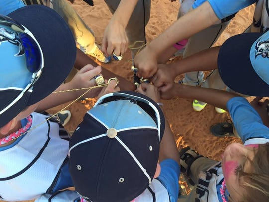 The Jupiter Tequesta Athletic Association's 11U Hammerheads recently were named champions of the 11U Minor Division. Team members wear their championship rings.