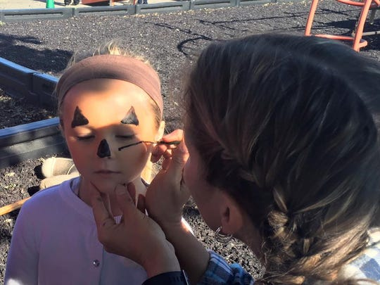 Students enjoyed face painting during the event.