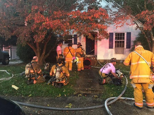 Firefighters work at the scene of a Salisbury fatal fire on Monday, Oct 24.