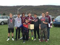 Southern Fulton's boys cross country team poses with its medals after winning the District 5 Class A championship on Wednesday. Pictured are team members, from left to right, Casey Spade, Nate Voight, Benjy Voight, Chase Varner (kneeling), Dylan Ensor, Sage Minteer, Liam Flaherty and coach Joe Hollenshead.