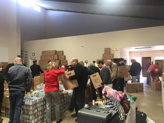 Santa's Helpers volunteers pack boxes for Christmas 2015.
