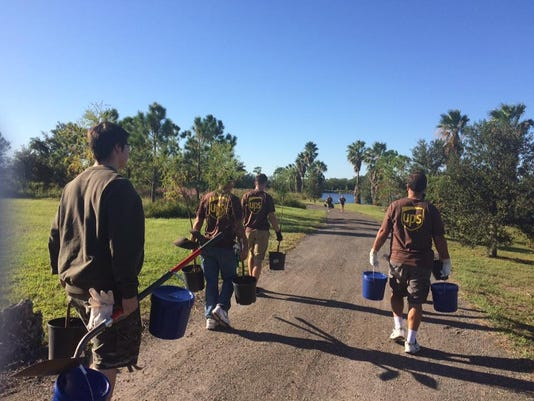 UPS-Employees-carrying-trees-to-be-planted.jpg