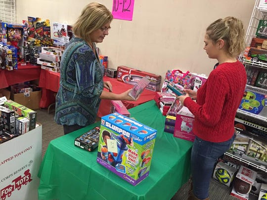 Toys for Tots volunteers LeeAnne Shannon and Charlee Zimmer sort toys on Nov. 8, 2016.