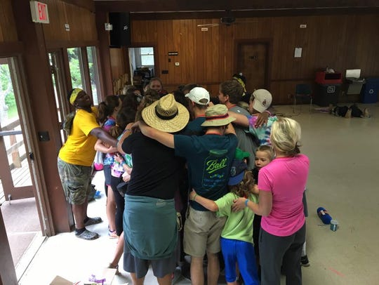 Camp Kesem campers and counselors huddle up for their