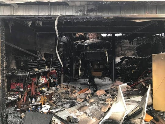 The charred remains of the interior of Hiram Auto Repair