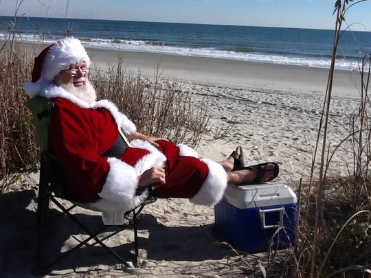 Ron Holshouser sits on the beach after a busy holiday season in 2014.