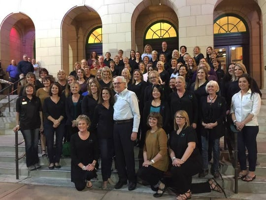 Bursch Travel employees celebrating 60th anniversary