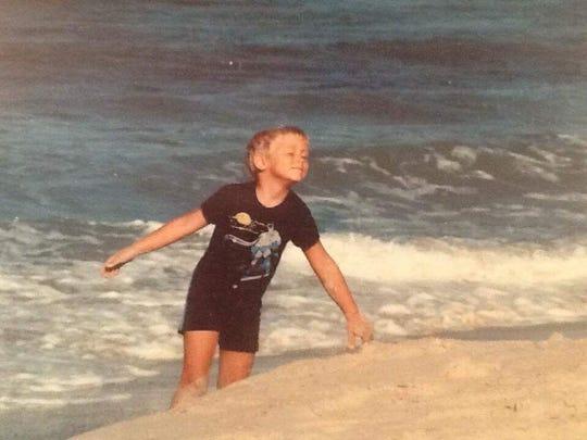 Keenan Stewart-Lyon plays in the surf near his home