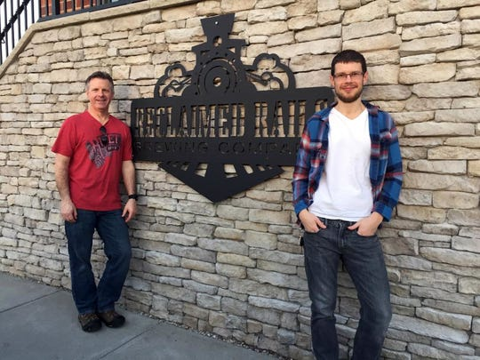Marc Bailey, right, and his dad, Clint, pose outside of Reclaimed Rails Brewery in Bondurant.