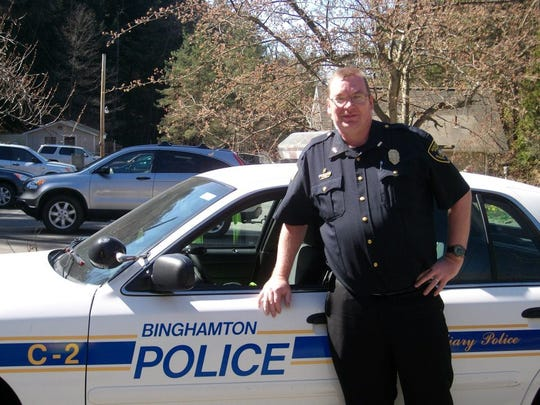 William Spangenburg, the assistant chief of the Binghamton Police Auxiliary, shows off the auxiliary's police car.