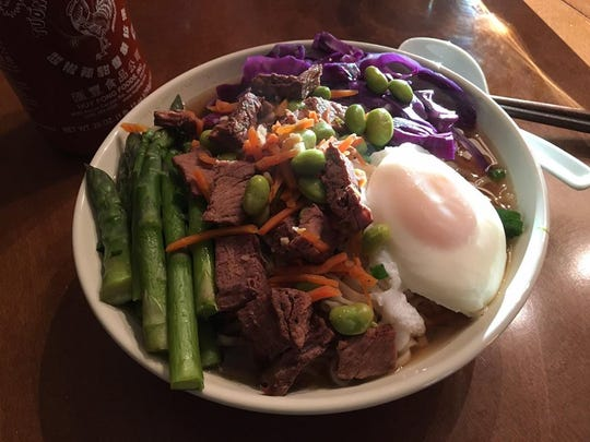 Erica Kissinger makes beautiful broth in her slow cooker, then pours it over noodles and finishes the dish with meat, veggies and a poached or fried egg.  It is best served with plenty of Sriracha.