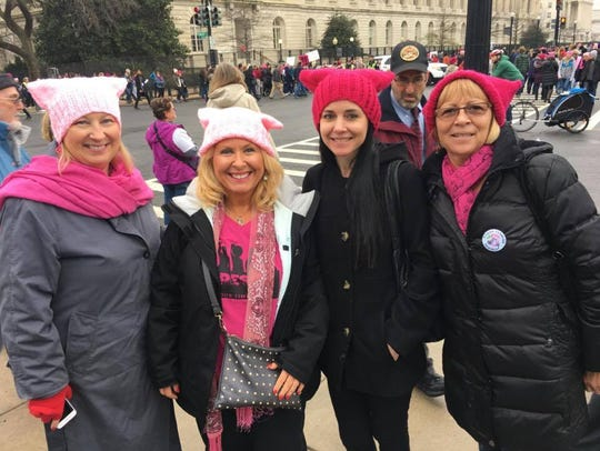 Brevard NOW members Terry Sanders, left, Laura Fausone, second from left, and Vicki Impoco, right, were joined by Impoco's daughter, Angela Impoco at the first Women's March on Washington in D.C. in 2017. Sanders and Vicki Impoco will return to D. C. for this year's Jan. 19 march, while Fausone will be a speaker at the Brevard Women's March at the Eau Gallie Causeway.