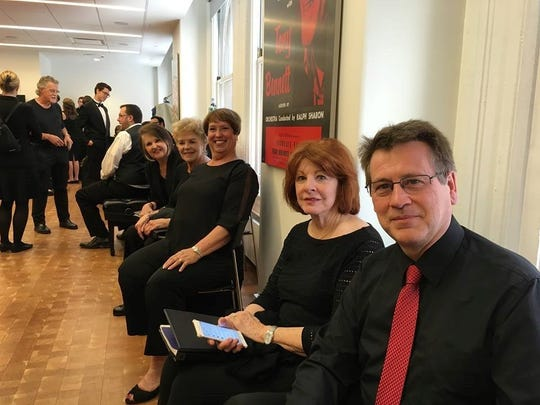 """Encore! choir members Karen Bacus (from left), Sue Vantrease, Debbie Koen and Fran Russell meet with Bravo! member Paul Renton before members of the two groups gave a performance of """"Requiem for the Living"""" at Carnegie Hall. The women's and men's choirs will join together March 5 for a performance of the piece at University United Methodist Church."""