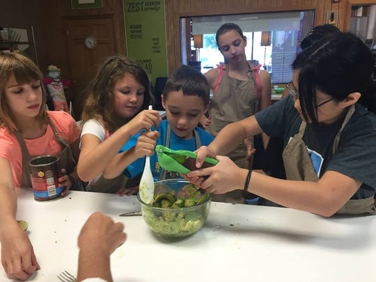 In the kitchen at the Food Happens summer camp.