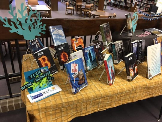 The Tuloso-Midway High School Library set up an display of titles whose authors will attend Teen Bookfest By the Bay. The third annual celebration of young adult literature will be from 9 a.m. to 5 p.m. Saturday at the American Bank Center.