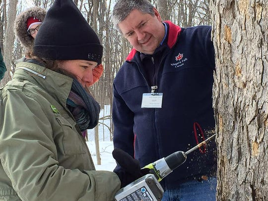 Scott Cherek leads a maple tapping workshop at Wehr