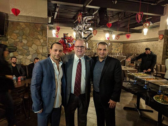 Garden City Mayor Randy Walker with Mandalay Bistro owners Mike Hariri  and Nafeh Bazzi.