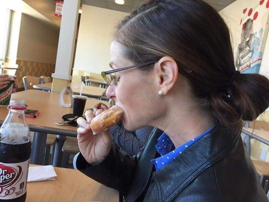 Lauren Lerner Gambill challenged herself to eat a doughnut.