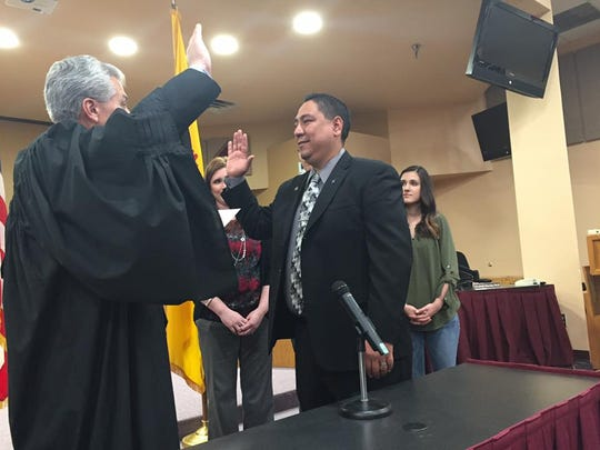 District Judge Fernando Macias administers the oath to Ray Jaramillo, who was elected to represent District 1 on the Las Cruces school board, at a ceremony held March 1, 2017, in the LCPS board chambers.