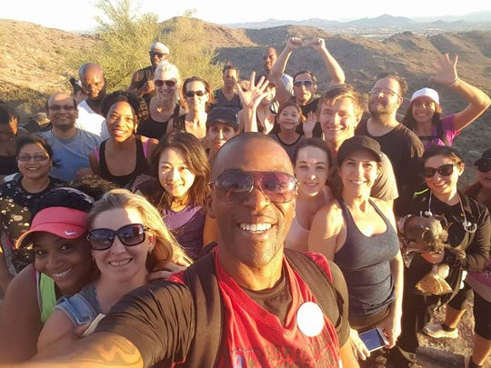 Gregory McClendon leads Living Chandler members on a morning hike at Camelback Mountain.