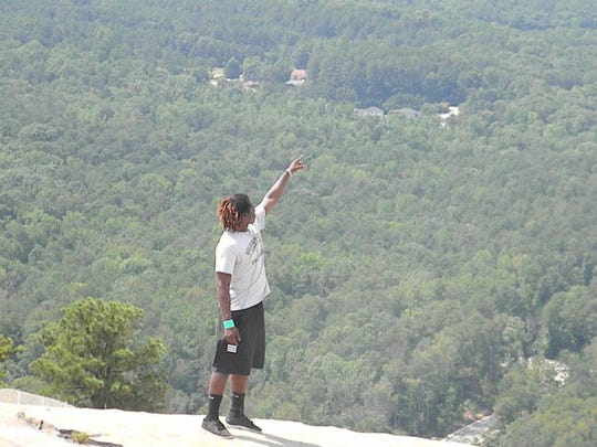 Former Golden Gate High School star football player and wrestler Lavanda Warren looks out during a visit to Stone Mountain Park in Georgia on a family vacation. Warren will wrestle for Florida A&M's club team in the NCWA national tournament beginning March 10, 2017.