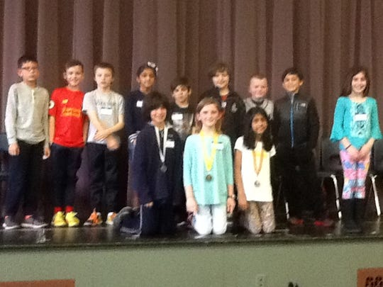 The third-grade spelling bee finalists include, front